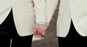 gay-grooms-hold-hands-Allegro-Photography